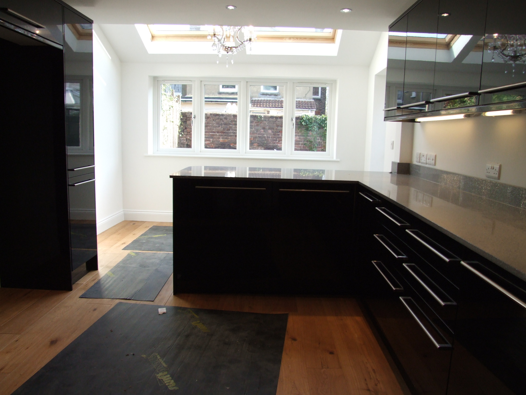 A shiny, modern newly fitted kitchen with extension